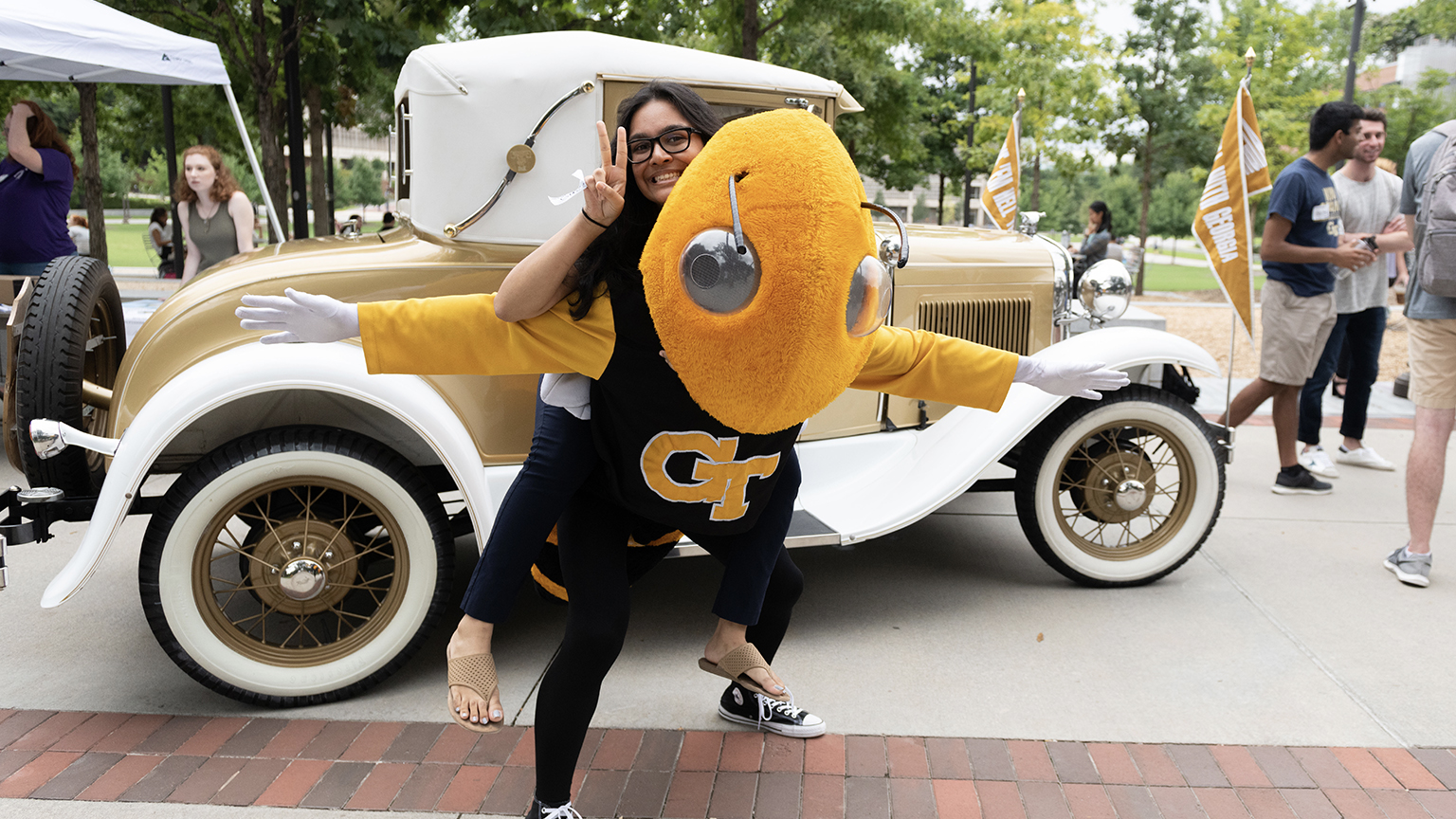 Buzz and a student celebrating being at Georgia Tech.