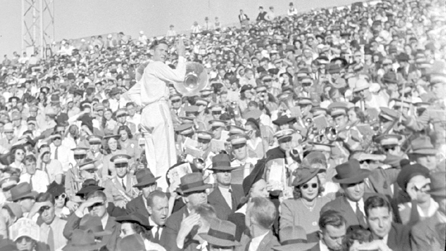 A shot of the crowd at a football game in the 40s.