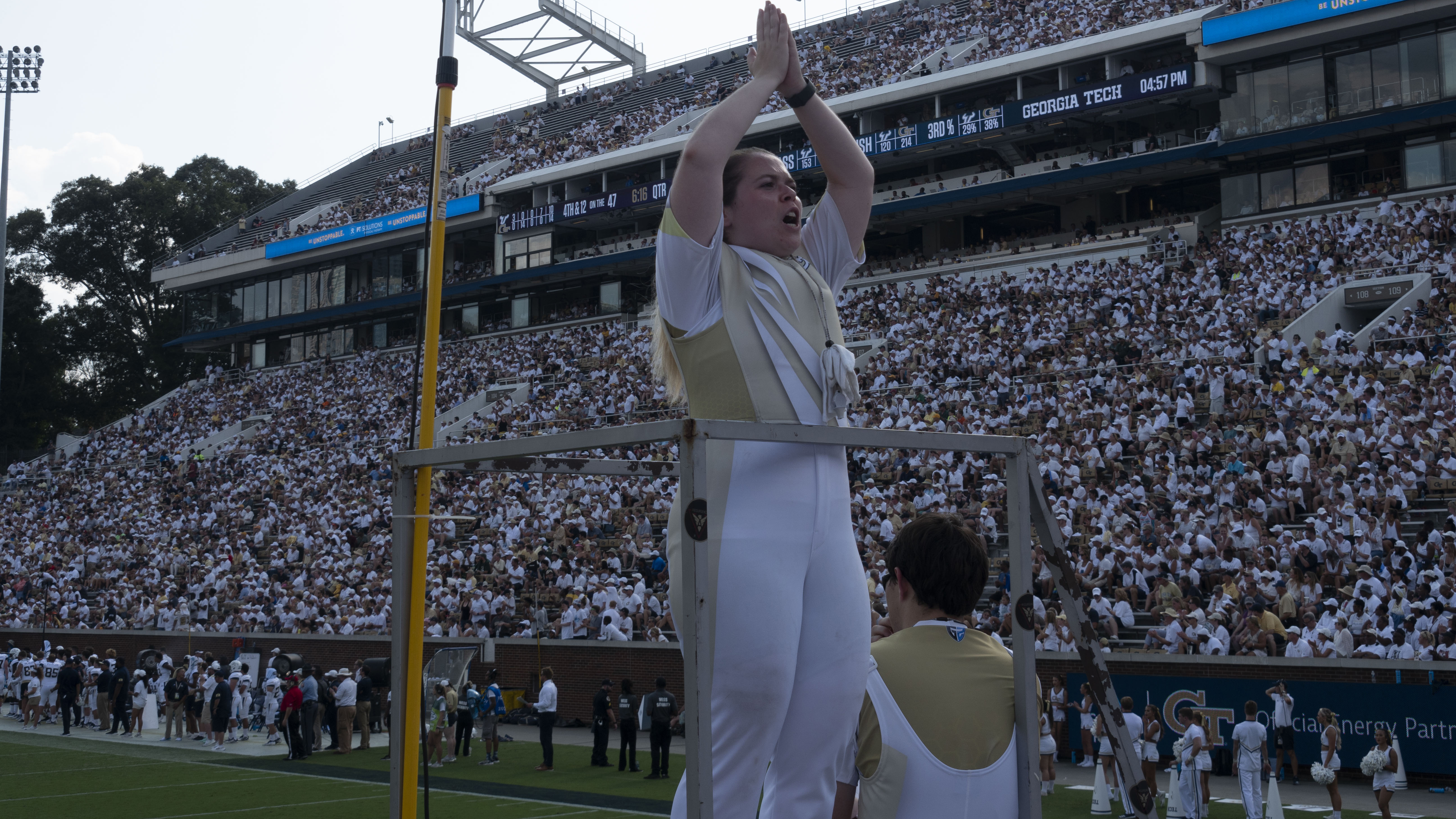 A drum major leading the band at a game.