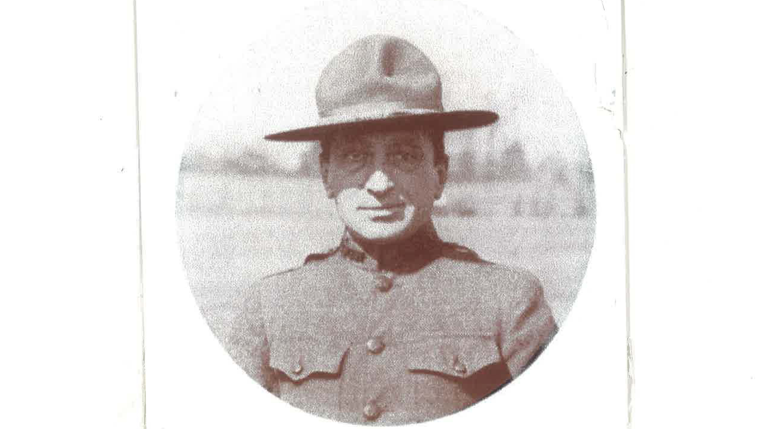 A close up of Frank Roman, wearing a military style hat.