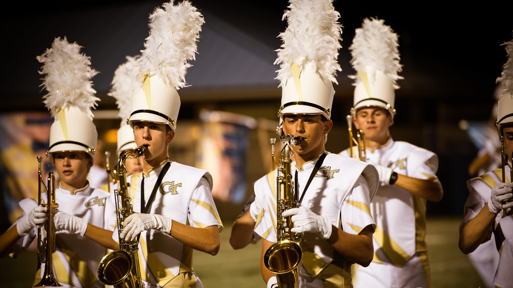 Members of the band playing saxophone.