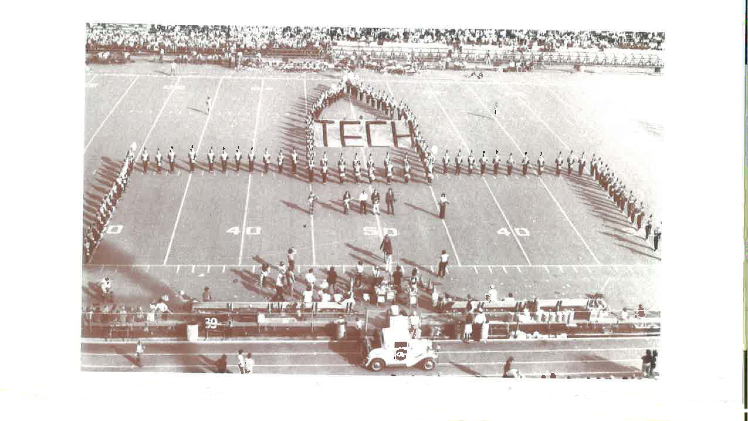 A shot of the Marching Band on the field of Bobby Dodd stadium in the 1970s.