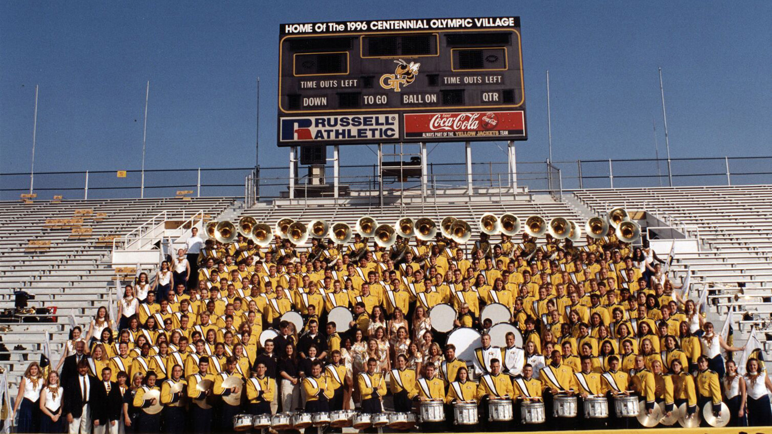 A shot of the 1996 Marching Band posing in the bleachers.
