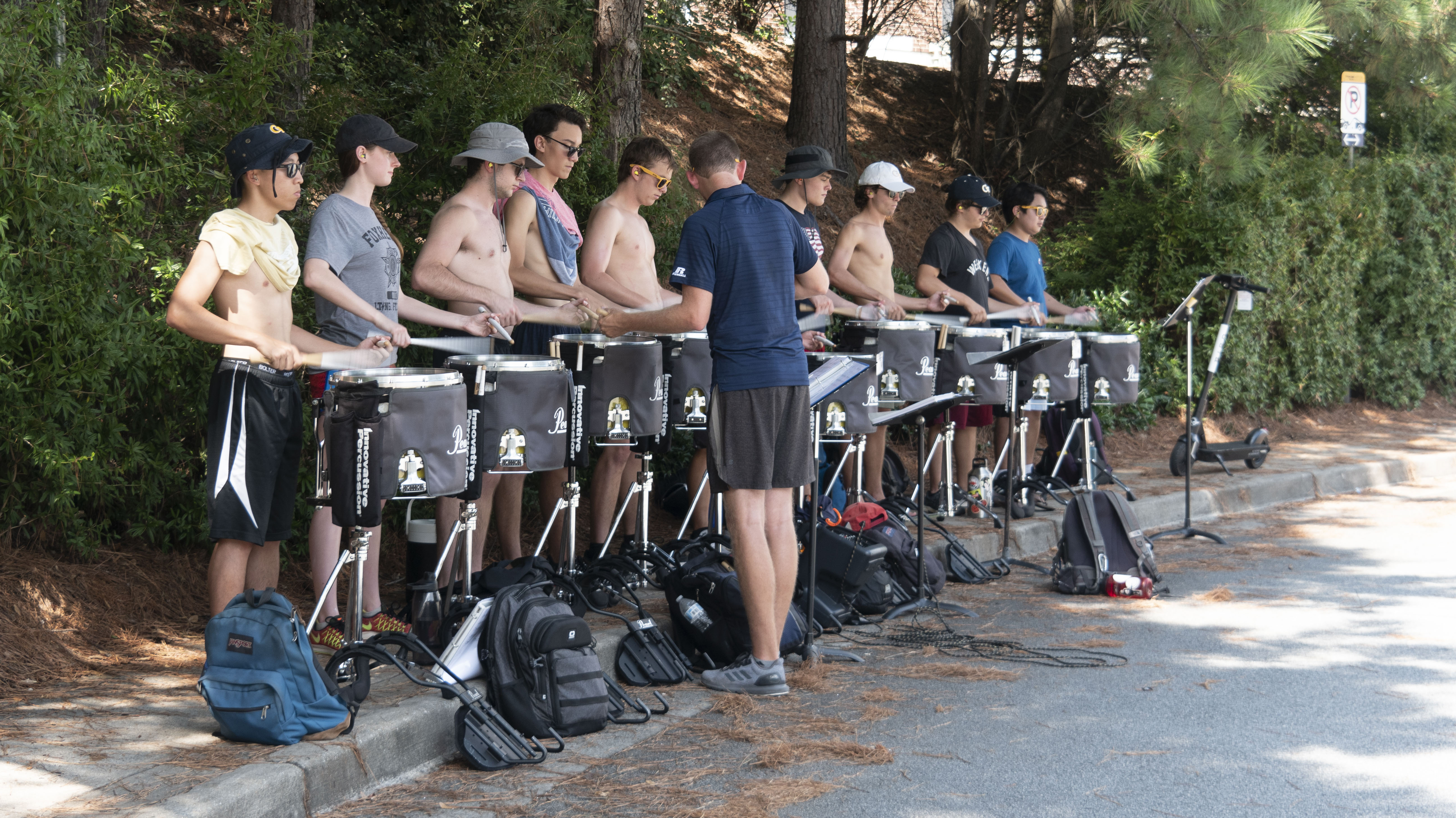 Members of the drumline practicing at camp.