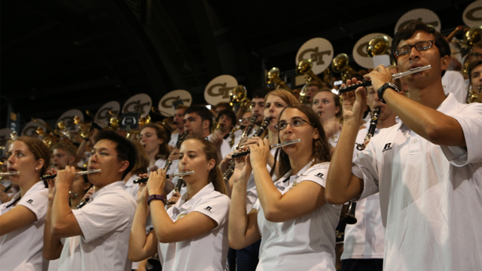 Members of the Pep Band performing at a game.